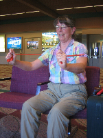 Dianne Roth works on arm strength in the airport.