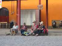 Sketching participants on a curb  in Oaxaca, Mexico