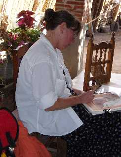 Dianne Roth sketching  in a weaving cooperative, Mexico